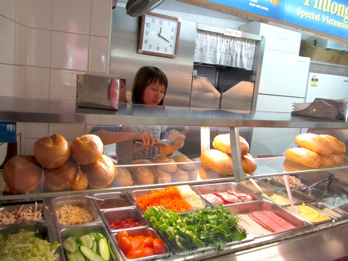 girl working at Vietnamese Banh Mi shop